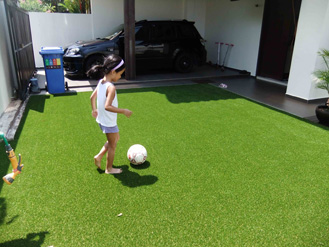 Kid playing on grass